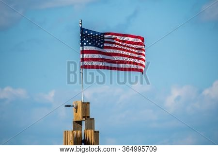 Rockport, Tx, Usa - April 18, 2019: A Us Flag On Top Of A Poll At Rockport Beach