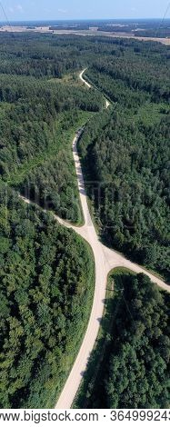 Summer Time Gravel Road In Forest, Aerial View, Vertical Pano