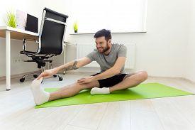 Man Stretching At Home. Man Doing Exercises At Home. Home Workout. Man Doing Sports At Home. Home Sp