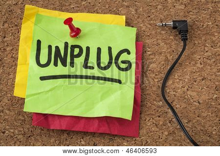 unplug  - lifestyle or information overload concept - handwriting on colorful sticky notes