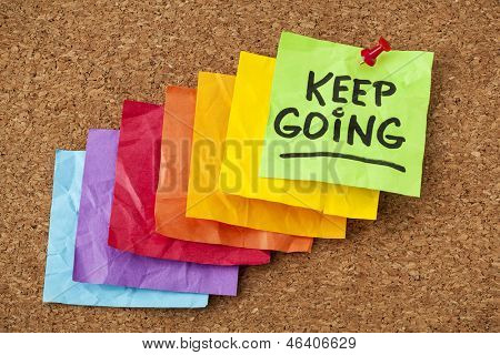 keep going - motivation or determination concept - handwriting on colorful sticky notes