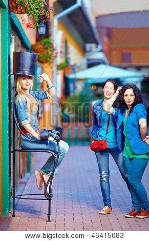 Beautiful Female Friends Having Fun In Tourist City