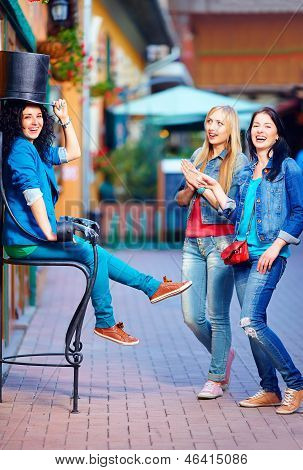 Happy Friends Having Fun In The Old City Street