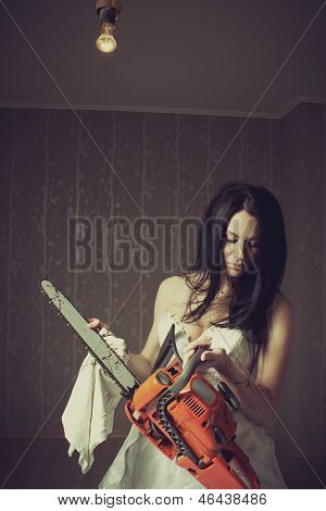 Woman Cleaning Her Chainsaw