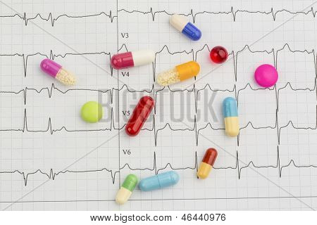 several tablets are on an ekg. symbolic photo for diseases of the heart and circulation