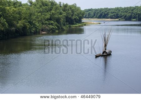 Bucolic scenery with sampan on Thu Bon River outside Hoi An, Vietnam.