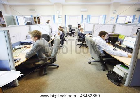 MOSCOW - AUG 15: Office workers of company RUSELPROM sit at computers in office, Aug 15, 2012 Moscow, Russia. RUSELPROM Group comprises 12 companies and affiliated companies.