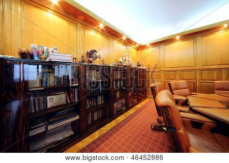 MOSCOW - AUG 15: Bookcase in office of company RUSELPROM, Aug 15, 2012 in Moscow, Russia. RUSELPROM Group comprises 12 companies and affiliated companies, producing electric motors, generators.
