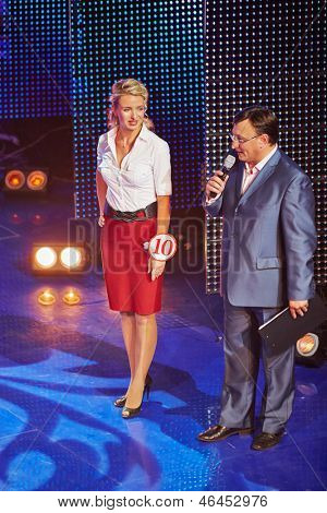 MOSCOW - AUG 3: General director of AHA company, emcee of competition Beauty of Russian Railways Maxim Aksenov and participant at number 10 on stage of central HCR, August 3, 2012, Moscow, Russia.
