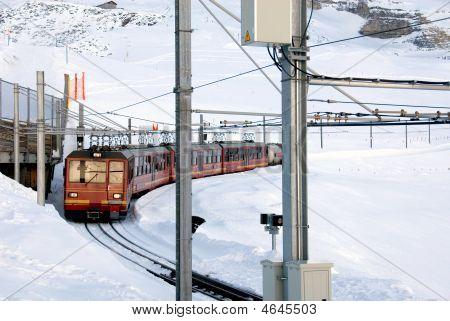 The train that runs from Kleine Scheidegg to the top of Jungfrau Switzerland poster