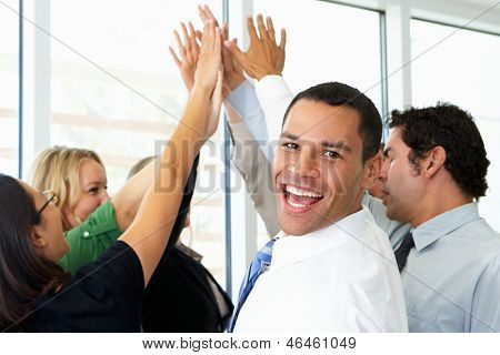 Business Team Giving One Another High Five