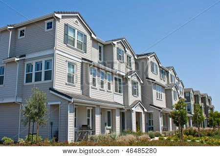 A row of new townhomes / condominiums in Morgan Hill, California. poster