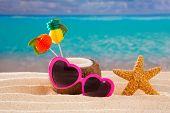 Coconut cocktail on tropical white sand beach heart shape funny sunglasses