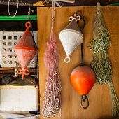 Detail of fisherman's nets and working tools at Lago Maggiore Italy poster