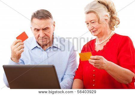 elderly couple doing online shopping.