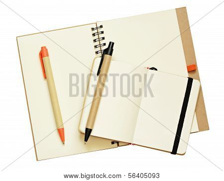 Opened Notebooks And Pens