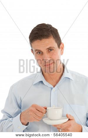 Middle-aged Man Savouring The Aroma Of A Cup Of Fresh Hot Coffee
