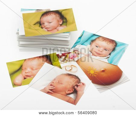 Pile of photographs on white background