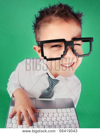 Five years old boy with a laptop computer, social media concept