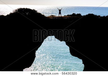 woman standing in a cliff