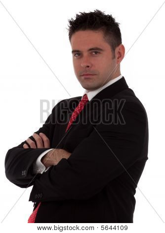 A Successful Young Businessman With His Arms Crossed A Neutral Expression