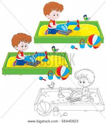 Boy play in a sandbox