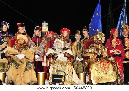TARRAGONA, SPAIN - JANUARY 5: The Magi are welcomed in a stage on January 5, 2013 in Tarragona, Spain. Later, the Magi and servants throw sweets to the children while parading in floats