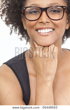 A beautiful intelligent mixed race African American girl or young woman looking happy and wearing geek glasses
