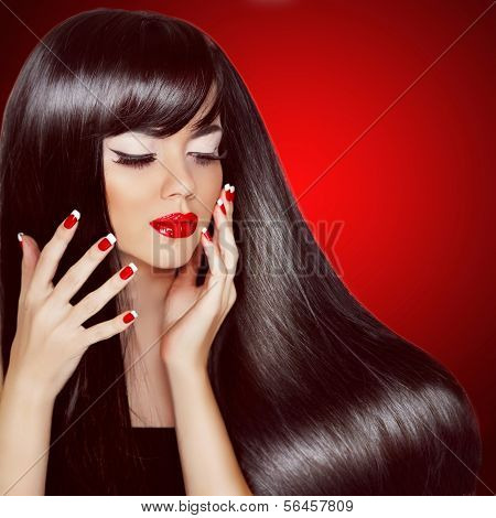 poster of Hair. Healthy Long Brown Hair. Beauty Brunette Woman with Smooth Gorgeous Hair and Makeup. Beautiful model girl portrait isolated on red background.