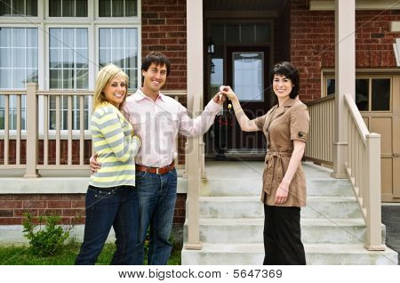 Happy Couple With Real Estate Agent