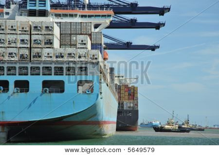 Container Ship And Tugs