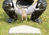 baseball catcher showing gesture for secret sign in field. poster