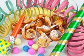 "Typical Italian dessert for carnival ""chiacchiere"" fries with toys and confetti. poster"