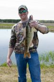 Fisherman holding up a trophy catch of a Walleye poster