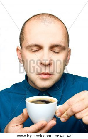 Adult Man Relaxing With A Cup Of Coffee