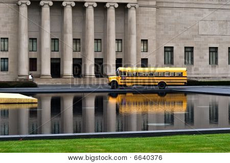 Field trips as a kid is something we remember for a lifetime. Here is a photo of a bus waiting for the kids on their fieldtrip. poster