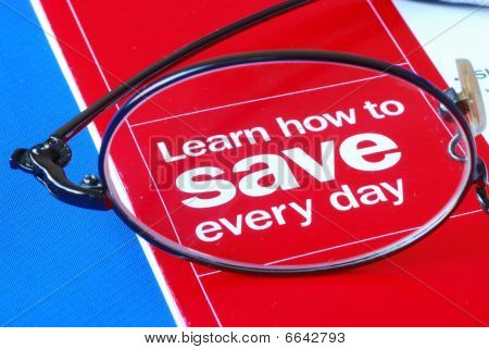 Focus on learning how to save money everyday isolated on blue poster