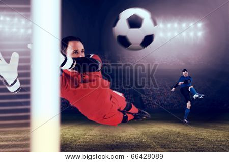 Fit goal keeper jumping up against large football stadium under blue sky poster