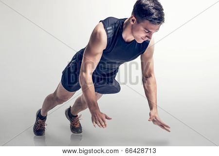 Sexy Young fashion sport muscle man, fitness model guy making push ups exercise