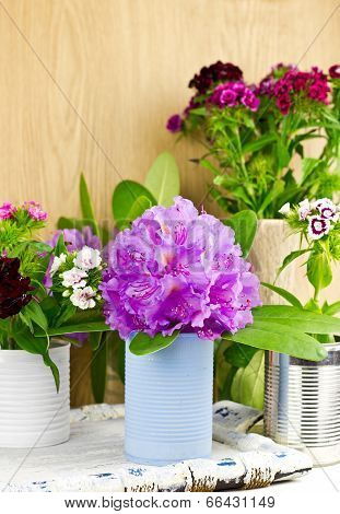 Different Colorful Spring Flowers With Handmade Vases, Selective Focus