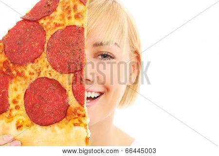 A picture of a happy woman covering her face with pizza over white background