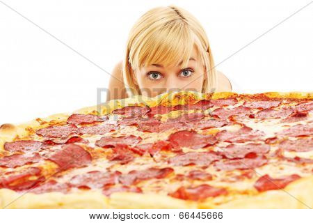A picture of a curious woman looking at pizza over white background