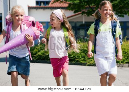 Three schoolchildren having fun