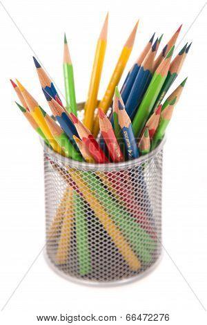 Coloured pencils in a tin