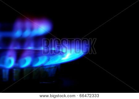 flames of gas stove in the dark poster