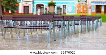 Rows Of Benches On City Street