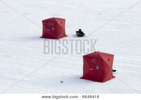 Two Ice Fishing Tents On Frozen Lake