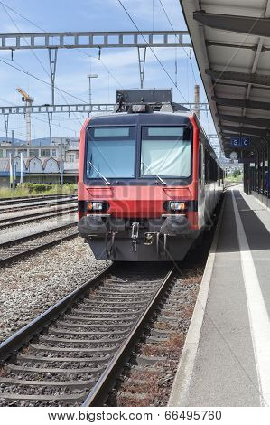 Suburb Train At The Train Station