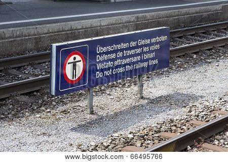 Multilingual Warning Sign At The Railroad Station Platform