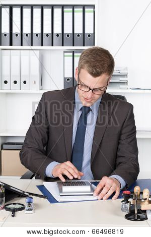 Young Businessman Is Performing Calculations